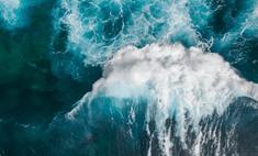Ocean waves roll in the ocean.