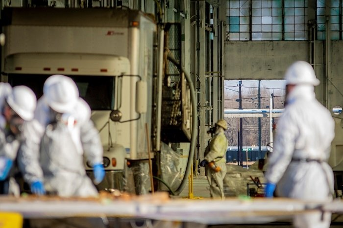 Workers conduct activities for a study of groundwater contamination beneath the C-400 Cleaning Building following deactivation of the facility.