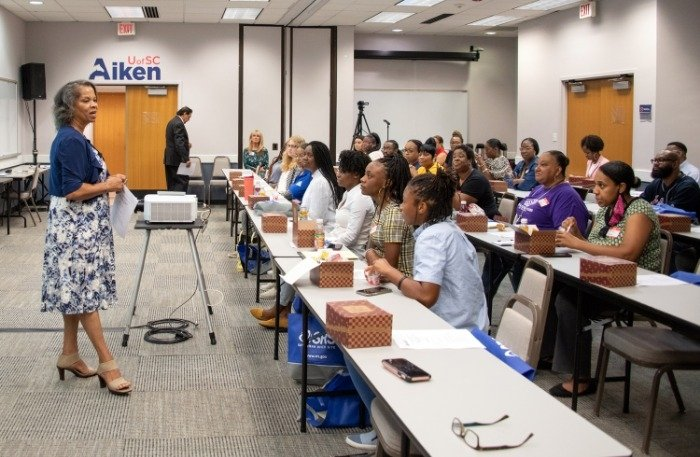 Rev. Brendolyn Jenkins Boseman, executive director of the The Imani Group, Inc., speaks to middle and high school teachers during the annual Teaching Radiation, Energy and Technology Workshop in Aiken, South Carolina.