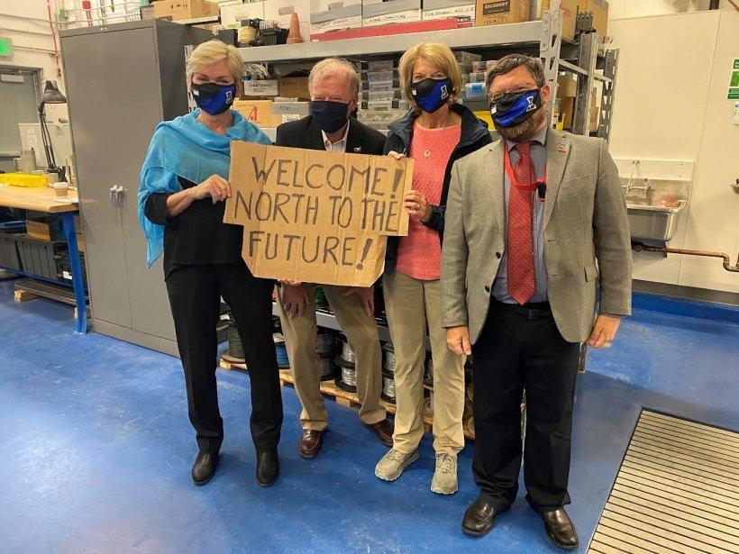 Energy Secretary Jennifer Granholm, left, stands with AOE Director George Roe, Sen. Lisa Murkowski and AEO Senior Advisor Mike McEleney at a power facility at the University of Alaska-Fairbanks.