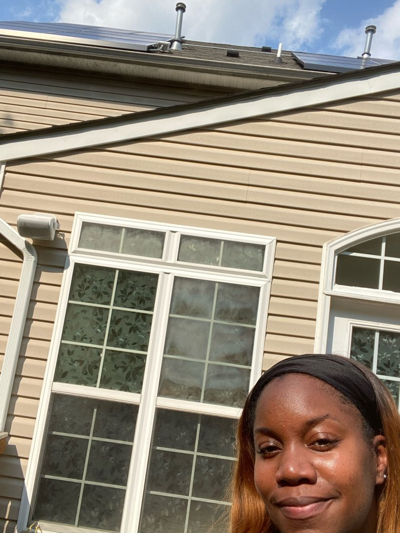 Lakisha Harris in front of her solar home.