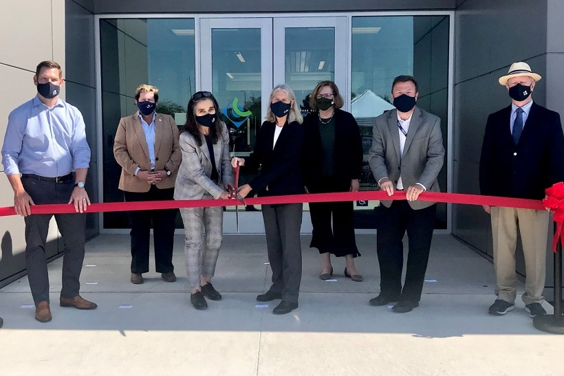 NNSA administrator, flanked by government and Lawrence Livermore National Laboratory officials cuts ribbon on new LVOC facility