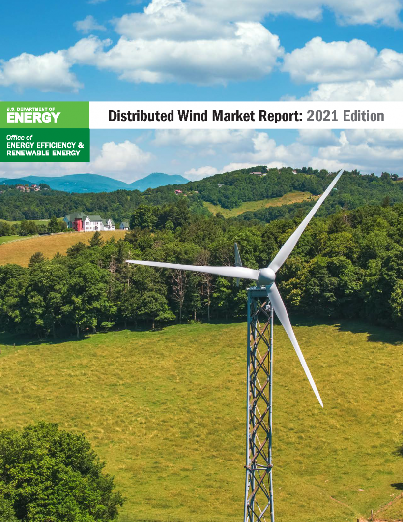 Mountains and trees with a distributed wind turbine in the foreground.