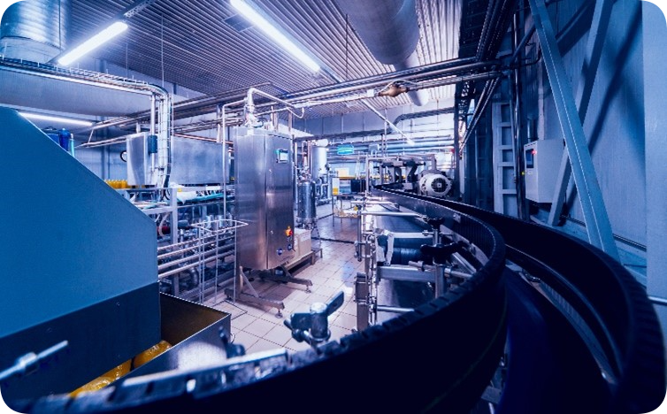 a photo from inside a manufacturing facility, with a long conveyer belt.