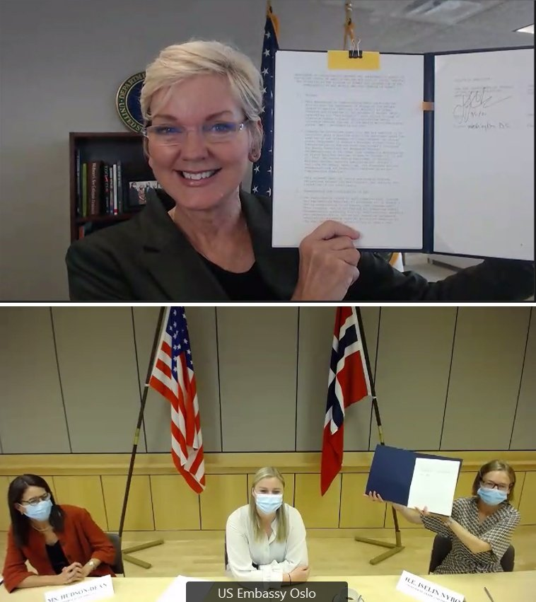 Secretary of Energy Jennifer M. Granholm, top, and Norwegian Minister of Trade and Industry Iselin Nybø hold up signed versions of the memorandum of understanding to advance a cooperative project to eliminate all of Norway's highly enriched uranium.