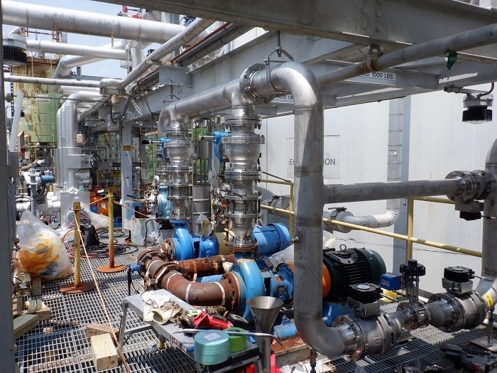 A view of the contrast between piping that is decades old — the rusted brown pipes in the foreground — and new piping workers are installing in the Liquid and Gaseous Waste Operations system at Oak Ridge National Laboratory. The replacements will alleviate the recurring need for maintenance and repairs and ensure the system's reliability.