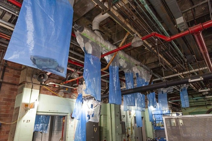 EM crews pre-staged and hung bags throughout the Beta-1 facility at the Y-12 National Security Complex before removing asbestos-containing materials.