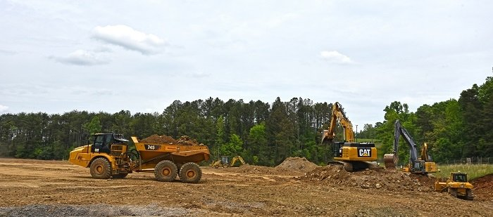 EM Oak Ridge cleanup contractor UCOR used nearly 5,500 trucks to bring in approximately 65,000 cubic yards of backfill soil to complete the former Centrifuge Complex area site restoration. Using soil from another location at East Tennessee Technology Park avoided $200,000 in costs.