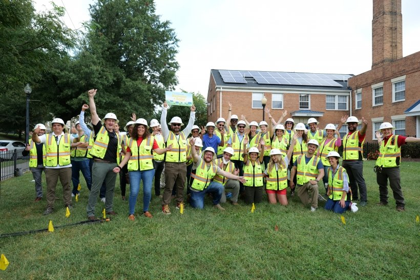 The team that completed the community solar installation celebrates outside of Crescent Park Village in Washington, DC.