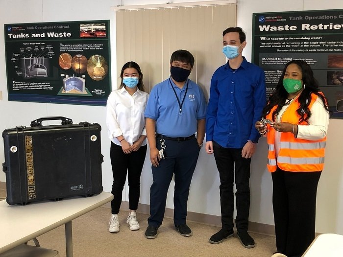 Florida International University interns, from left, Thi Tran, Jeff Natividad, and Joel Adams, meet with Nicole Nelson-Jean, EM Associate Principal Deputy Assistant Secretary for Field Operations, far right, during her visit to the Hanford Site in June 2021