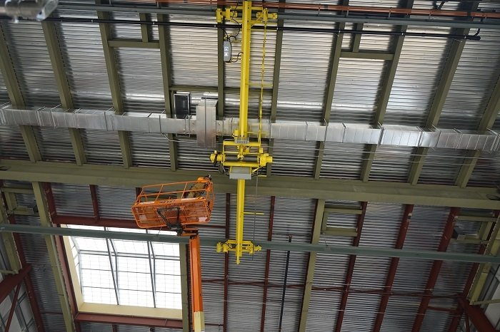 Pictured on a lift, Rick O'Hair, a rigger with crane consultant Paul Parish Ltd., monitors a ceiling-mounted crane at the Low-Activity Waste Melter Assembly, Storage and Transportation facility near the Hanford Site during recent load testing.