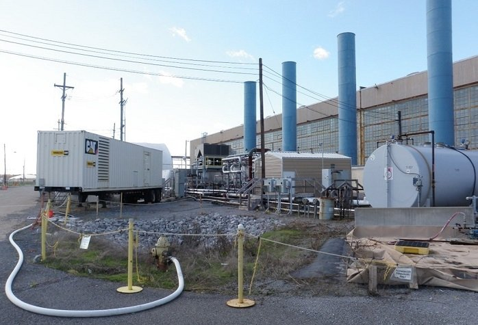 Pictured here are the equipment, tanks, and other items on the east side of the C-400 Cleaning Building at the Paducah Site. These items were removed, in part, to prepare for a remedial investigation that will allow EM to evaluate the source of off-site groundwater contamination located under the building.
