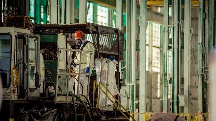 Paducah Site workers conduct drilling and groundwater sampling activities inside the C-400 Cleaning Building after the facility was deactivated. Since November 2019, EM has conducted field work as part of an ongoing groundwater investigation at the C-400 Complex, which includes the building and surrounding areas.