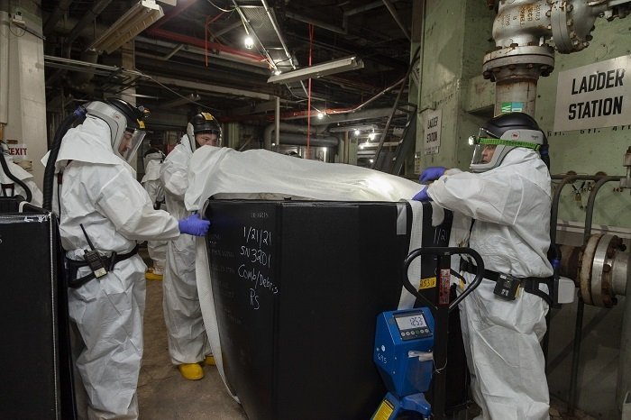Workers remove waste from Alpha-2 as part of deactivation work at the Y-12 National Security Complex at Oak Ridge.