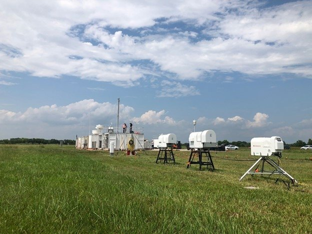 Clouds over the Department of Energy (DOE) Atmospheric Radiation Measurement (ARM) mobile user facility in La Porte, Texas, as researchers set up equipment for the TRacking Aerosol Convections interactions ExpeRiment (TRACER).
