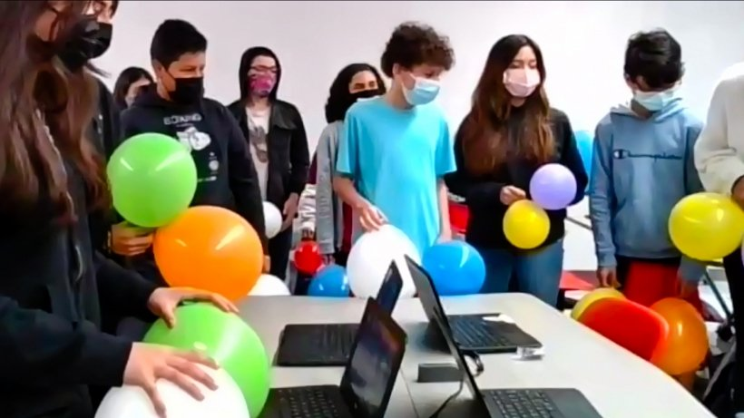 Students ready their balloons for a hands-on experiment about nuclear fission. The experiment was part of a virtual demonstration hosted by the Argonne Hispanic/Latino Club ERG during Hispanic/Latino Education Outreach Day.