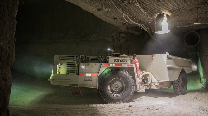 A salt haul truck turns a corner into Panel 8 in the Waste Isolation Pilot Plant underground. The haul trucks take salt from a continuous miner machine in Panel 8 to a salt hoist for transport to the surface. Panel 8 mining, recently completed, totaled more than 157,000 tons of mined salt.
