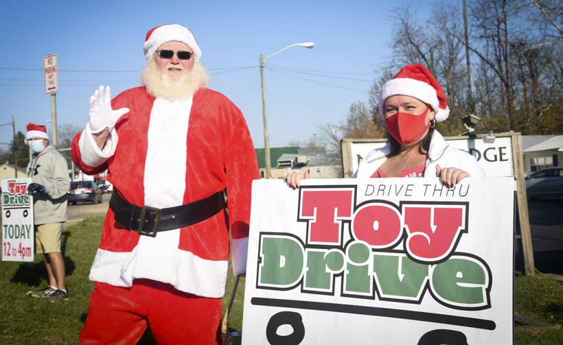 Fluor-BWXT Portsmouth's Christmas Gifts for Children program recently hosted a Drive-Through Toy Drive at the Waverly Moose Lodge in Ohio. Pictured are FBP's Jeff Riley (Santa Claus), and event organizer Kylea Barnes.