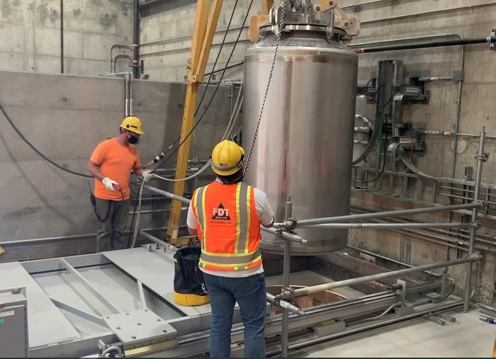 Workers at the Hanford Waste Treatment and Immobilization Plant test the Low-Activity Waste Facility's container handling system.