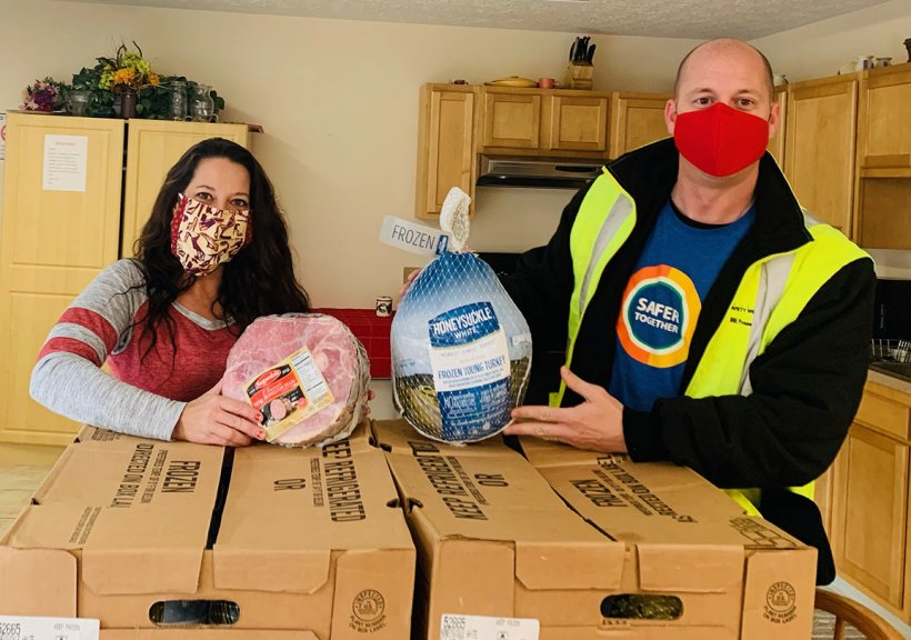 Southern Ohio Domestic Violence Shelter was one of several local charities receiving a special delivery of turkeys and hams for the holidays. Pictured, from left, is Sara Justice, Southern Ohio Domestic Violence Shelter, and Todd Cron (FBP).