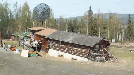 A private house north of Fairbanks is unevenly sinking into thawing ice-rich permafrost.