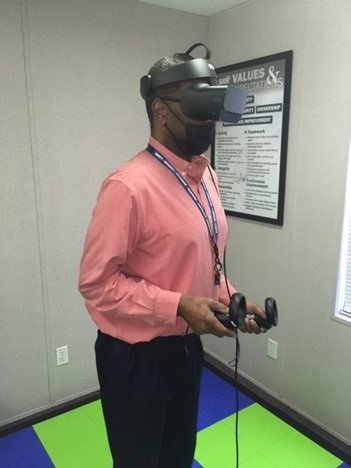 Defense Waste Processing Facility Crane Manager Robbie Robinson uses 3D virtual reality equipment to view images from inside the Salt Waste Processing Facility.