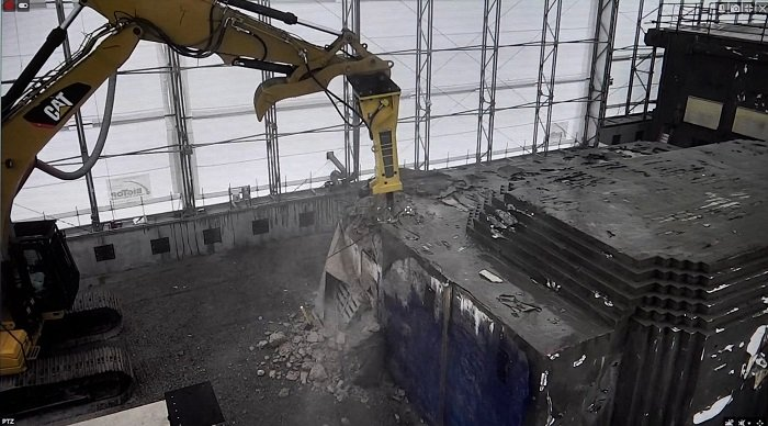 A view of the demolition of a hot cell inside a protective cover at the former Radioisotope Development Lab at Oak Ridge National Laboratory.