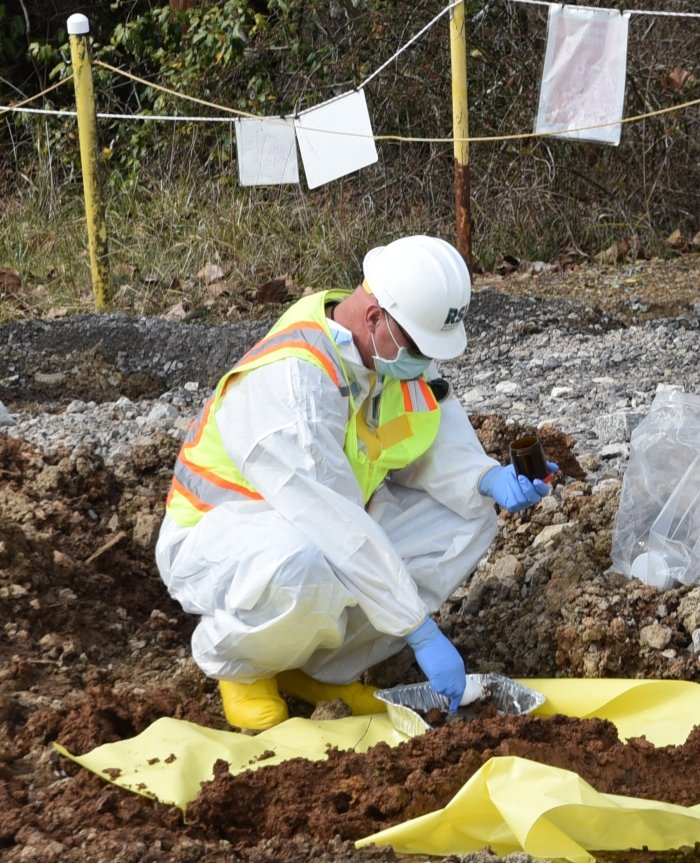 Employees collect samples to identify areas of soil that require removal. They also conduct confirmatory sampling to ensure the removal of all contamination following completion of the project.
