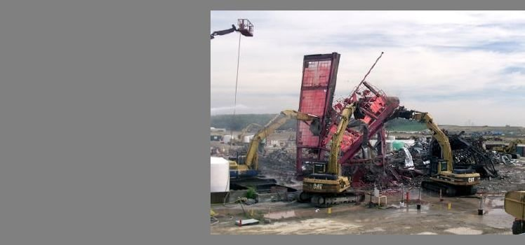 Demolition crews bring down the Pilot Plant at DOE's Fernald Closure Site in Ohio.