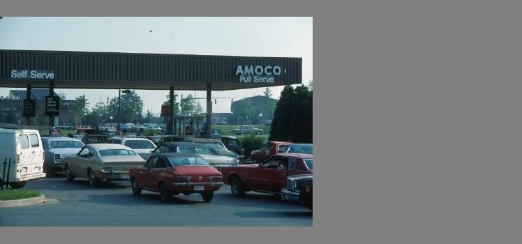 Cars waiting in line at a gas station due to the 1973 OPEC oil embargo