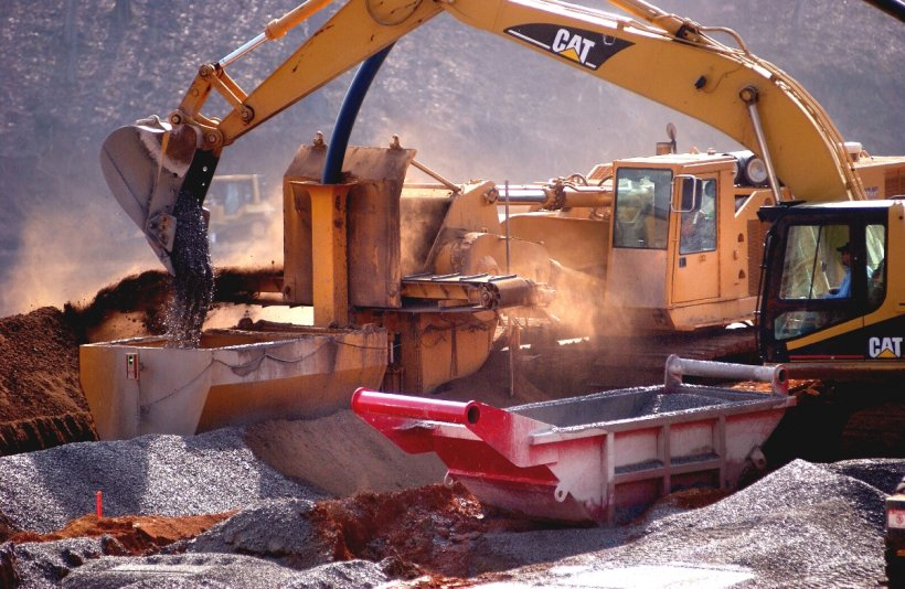 Heavy machinery performing cleanup work