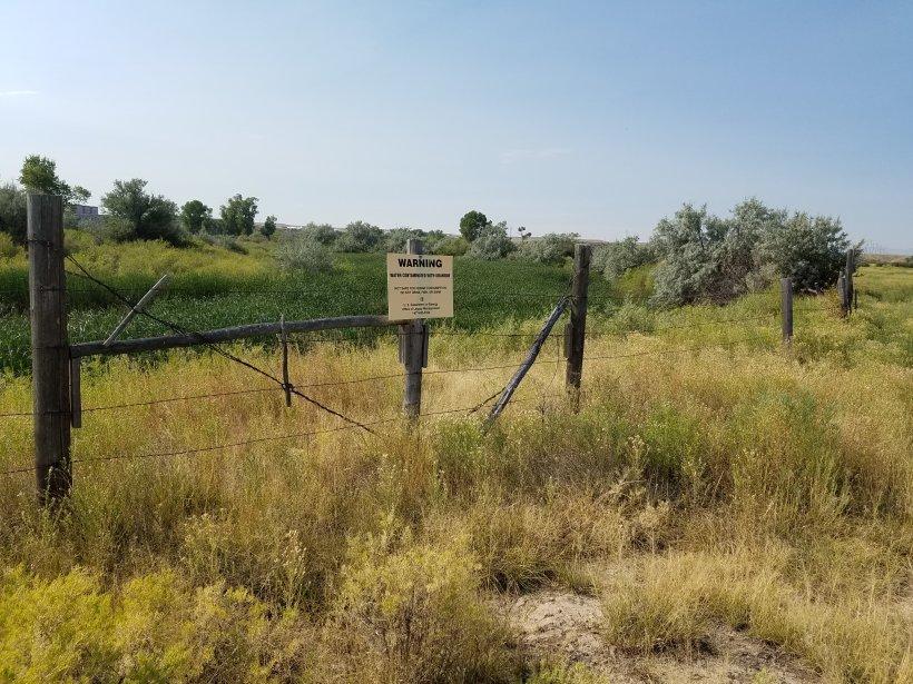 Riverton, Wyoming, Oxbow Lake and Warning Sign.