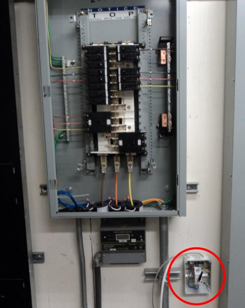 Wireless metering system during installation for communications test, with a red circle around an affected area.