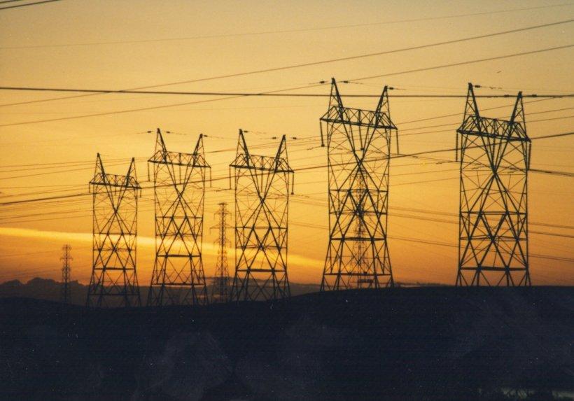 A row of power lines against a sky at dusk.