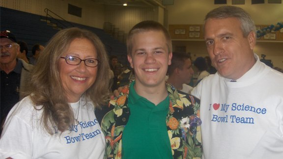 Champion Sam Elder poses with Poudre High School principal Sandra Lundt (L) and Colorado Governor Bill Ritter (R) after his 2007 National Science Bowl® win.