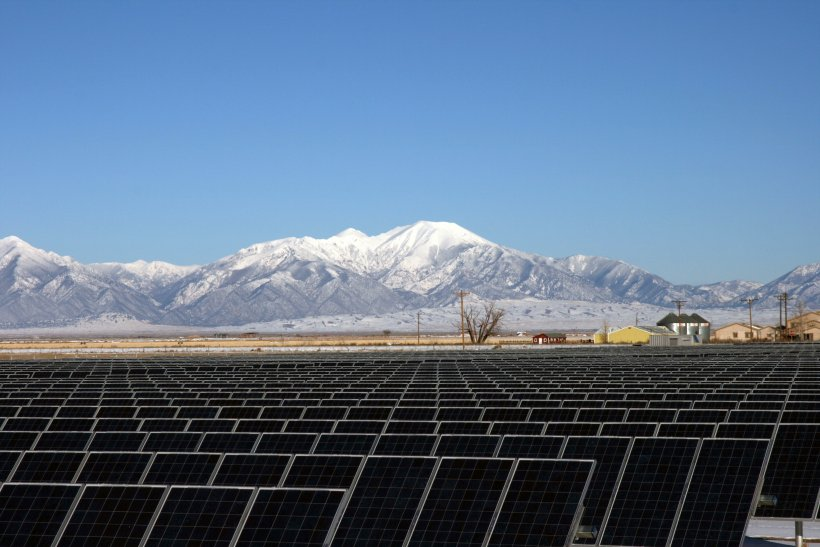 Solar panels at the National Renewable Energy Lab with mountains in the background.
