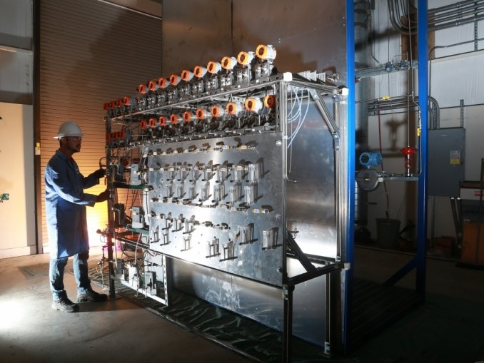 An engineer monitors a feed control system for a new, energy efficient pilot process for producing ethylene, one of the most energy-intensive and commonly manufactured chemicals.