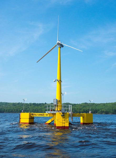 A 65-foot tall, 20-kilowatt wind turbine with a white rotor and a yellow tower on a floating platform in the ocean.