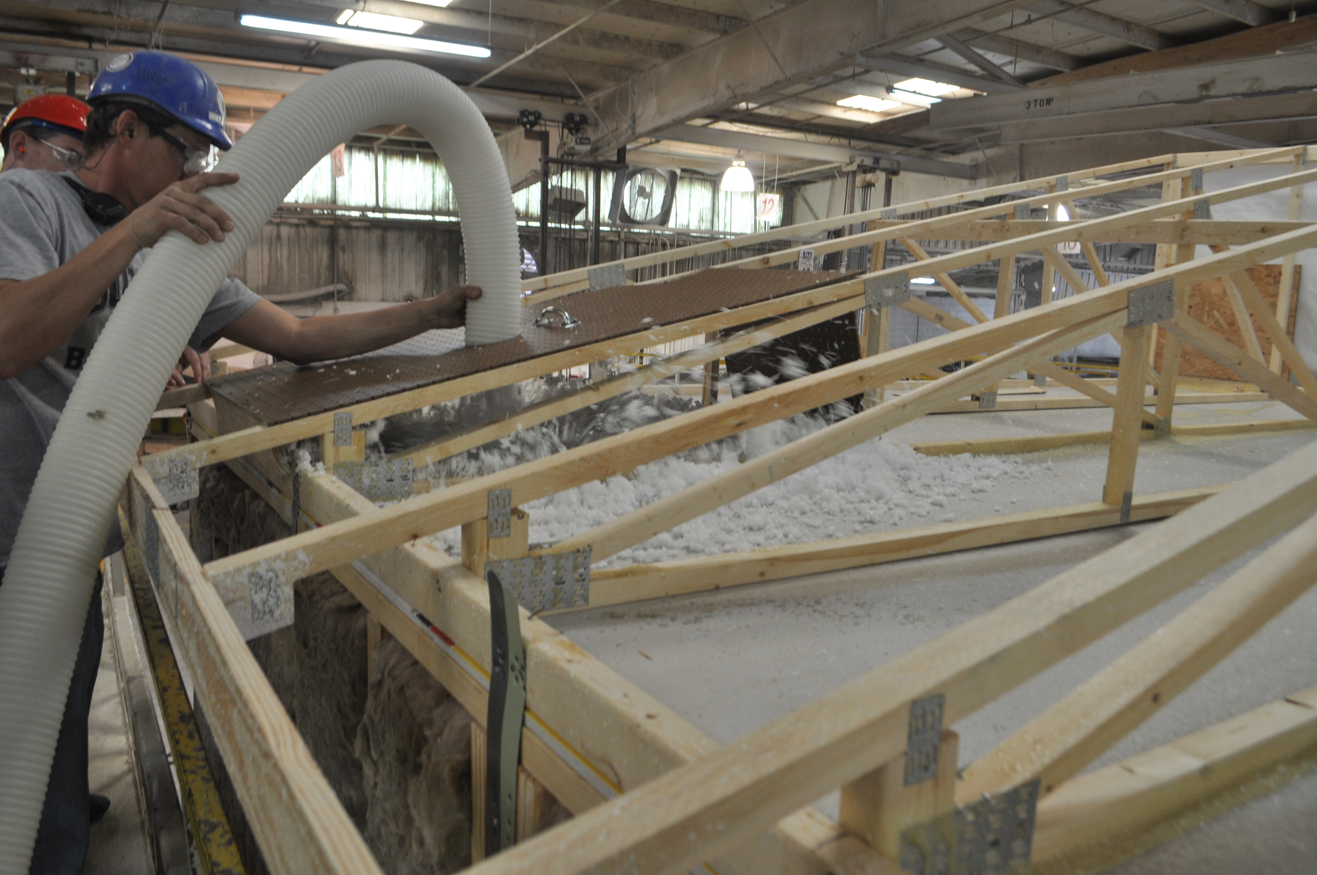 Cost optimized attic insulation solution for factory built for Americas best home builders