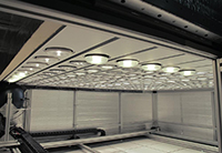 A testing chamber with rows of installed PAR38 lamps.