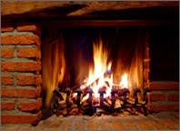Photo of a fire in a brick fireplace. Copyright iStockphoto.com/Oliver Malms.
