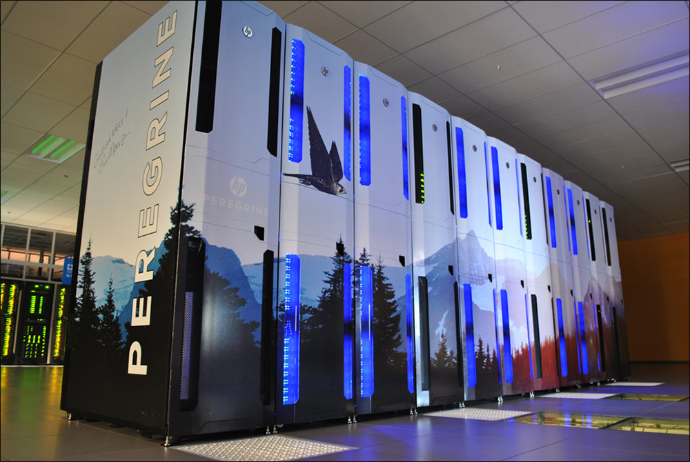 Photo of a high-tech data center shows a long tall bank on servers.
