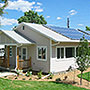 Photo of a house with solar panels.