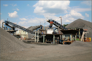 Image of conveyer belt and gravel at mining facility