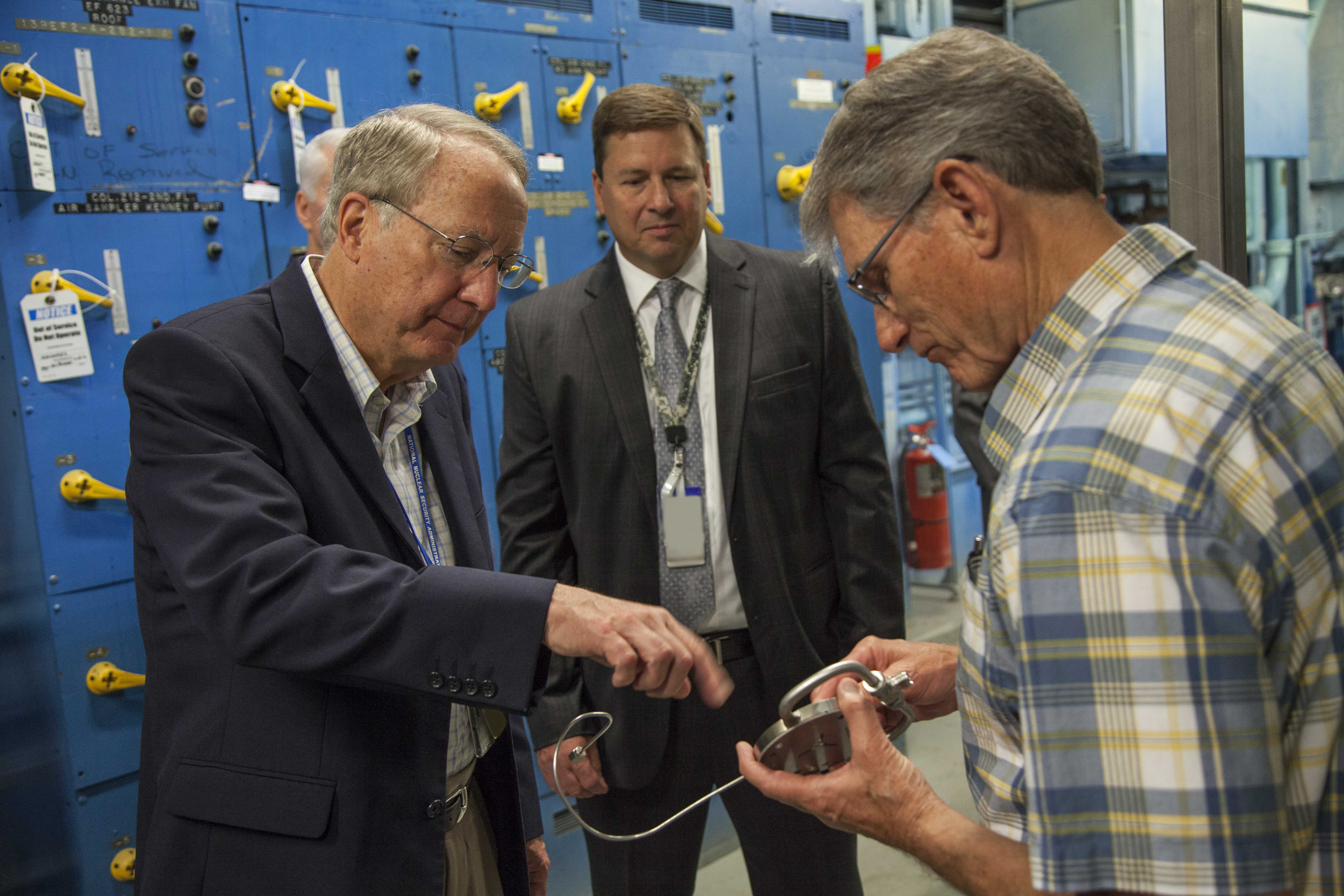 Team members are vital to keeping the U.S. ‪nuclear‬ deterrent safe, secure, and effective. Roland Seals, right, one of Y-12's inventors, describes a piece of instrumentation used in the site's R&D work to Klotz. Looking on is Randy Dziendziel, Y-12 Development manager.