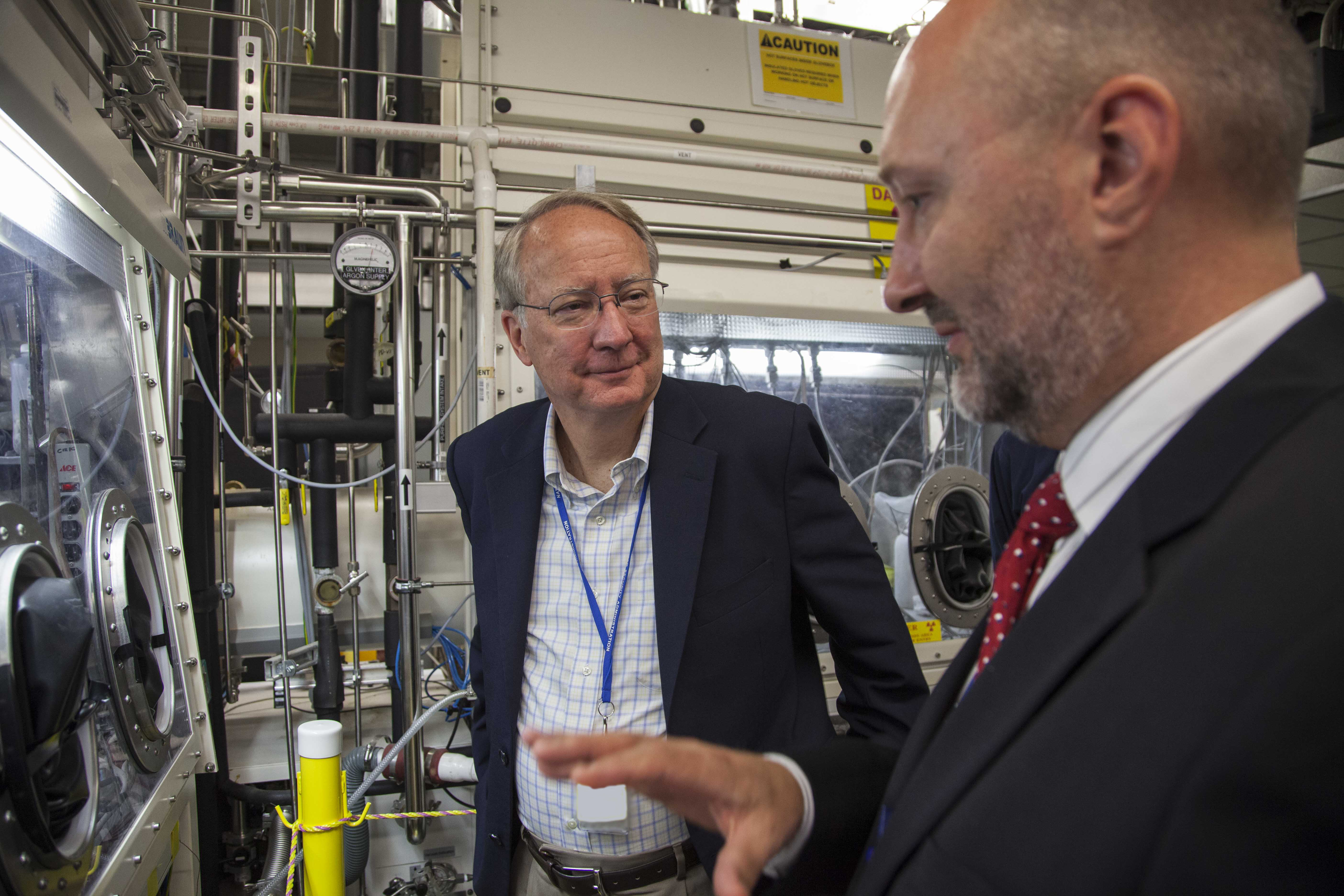 Greg Schaaff of Y-12's Development organization, right, discusses the site's uranium research efforts with Administrator Klotz. With more than 70 years of handling and securing the material in its many forms, Y-12 is the nuclear security enterprise's leader in all things uranium.