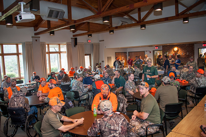 Hunters and volunteers gather during the Savannah River Site Mobility Impaired and Wounded Warriors Deer Hunt at the Savannah River Ecology Lab Conference Center in Windsor, S.C.
