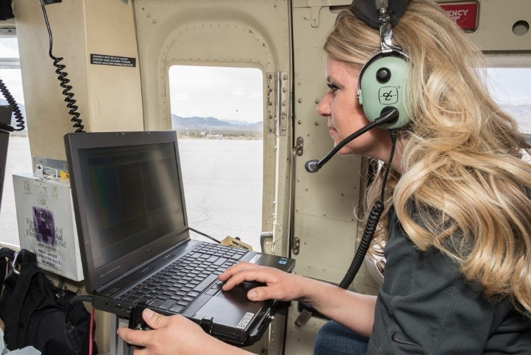 AMS Mission Scientist Ashlee Dailey oversees data collection onboard a Department of Energy helicopter.
