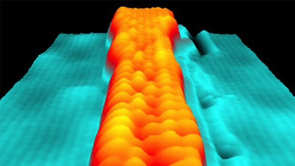 Scanning tunneling microscopy image shows a variable-width graphene nanoribbon. Atoms are visible as individual
