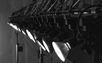 Photo of a row of PAR38 lamps attached to a truss system.